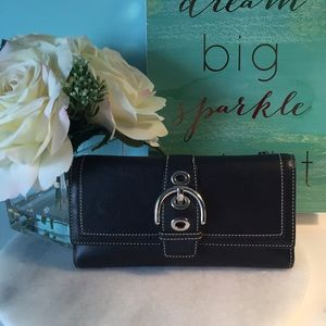 Coach leather black full size wallet.